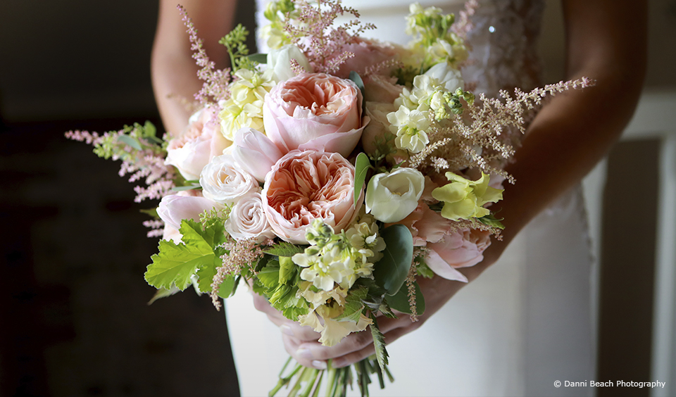 The bride chose a wedding bouquet that included peonies for her summer wedding at Upwaltham Barns
