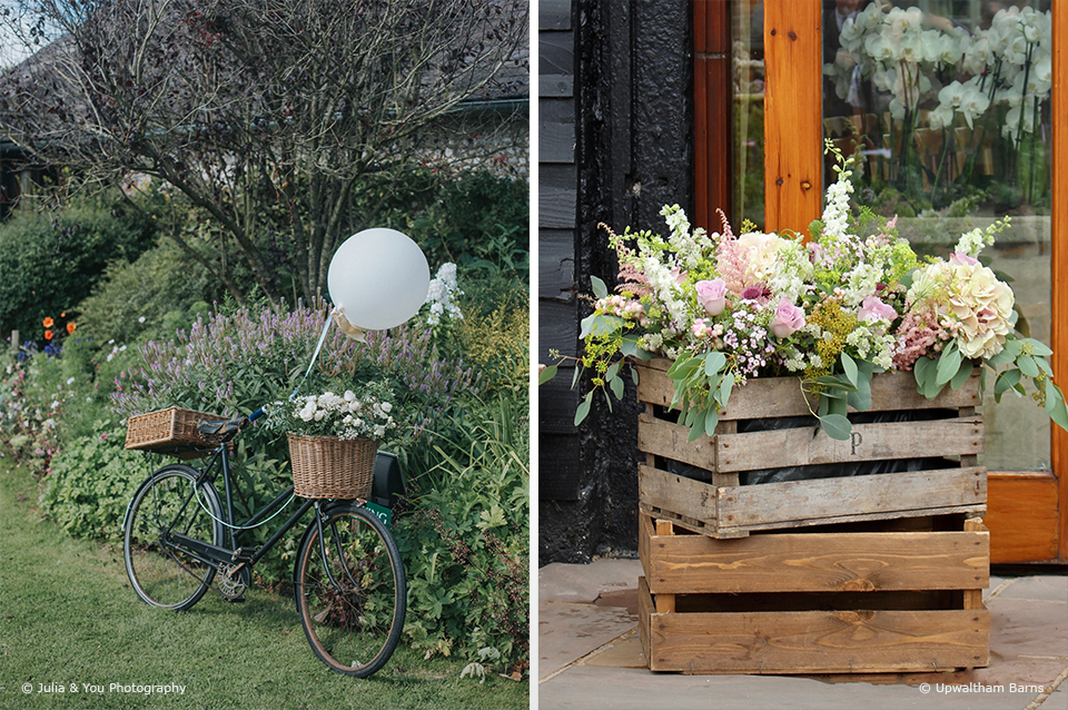 Apple crates are filled with wedding flowers for a rustic wedding decoration at Upwaltham Barns