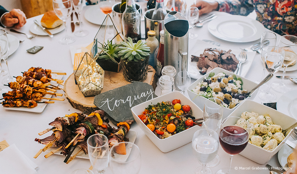 A bbq is served for a summer wedding breakfast at Upwaltham Barns