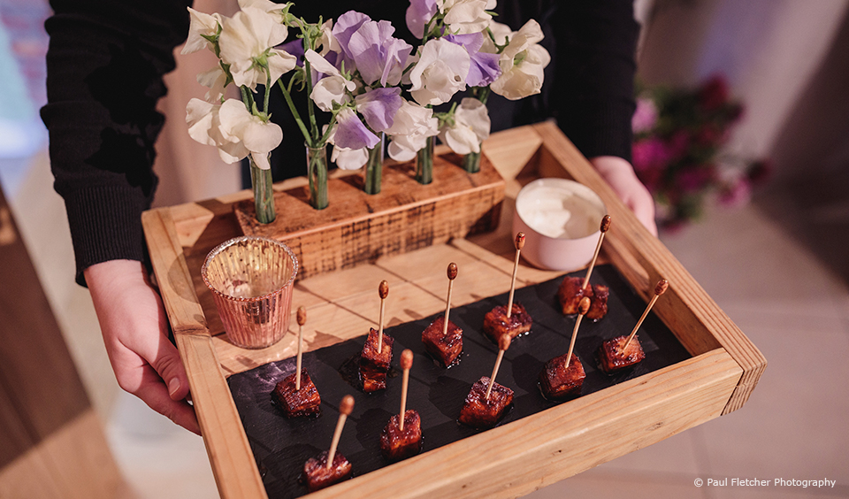 A selection of canapes are served during a wedding reception at Upwaltham Barns