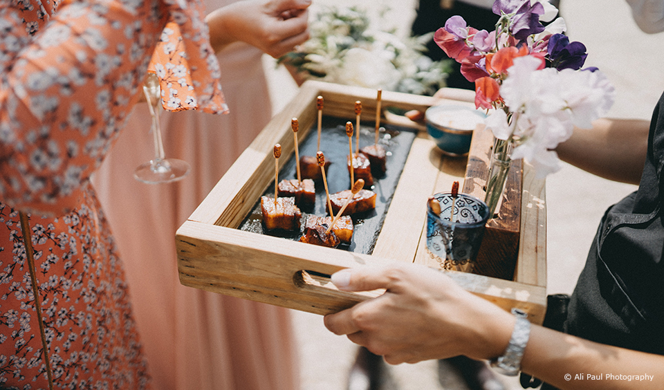 Canapes are served during a summer wedding reception at Upwaltham Barns